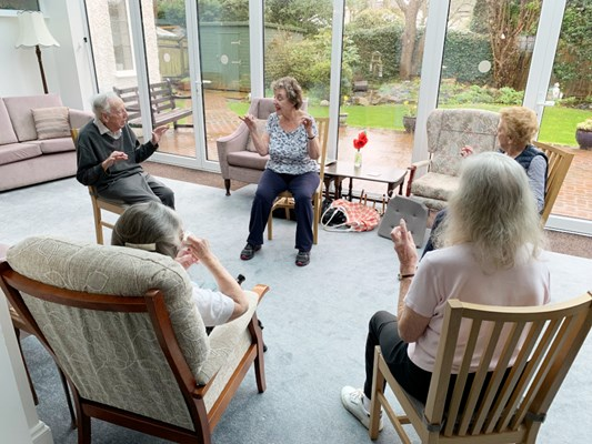 Residents taking part in armchair exercises at The Wyke