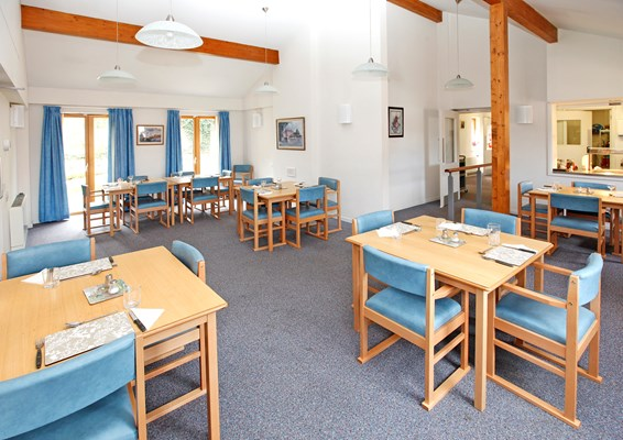 Bright and spacious communal dining area where residents share mealtimes together