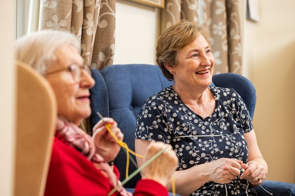 Happy residents doing some knitting together at Culver House