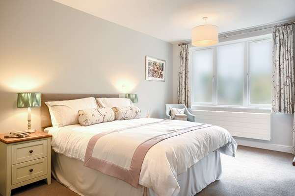 A beautiful large bedroom with soft lighting