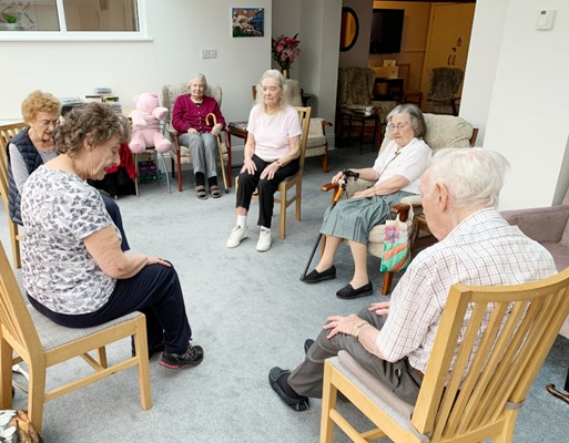 Residents taking part in some armchair exercises in the lounge
