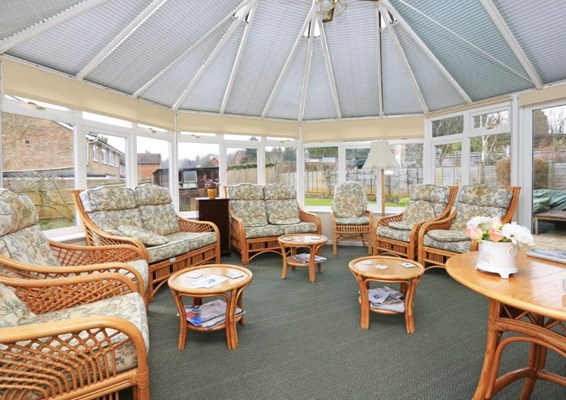 Bright conservatory where residents can socialise and catch up