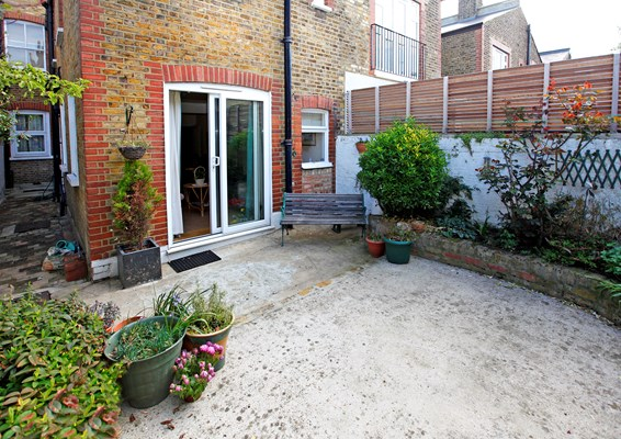 Back garden with bench so residents can enjoy a breath of fresh air at Abbeyfield House, Fulham