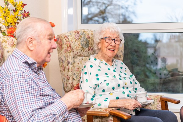 Residents at Cotmaton House enjoy a catch over a cup of tea at Cotmaton House