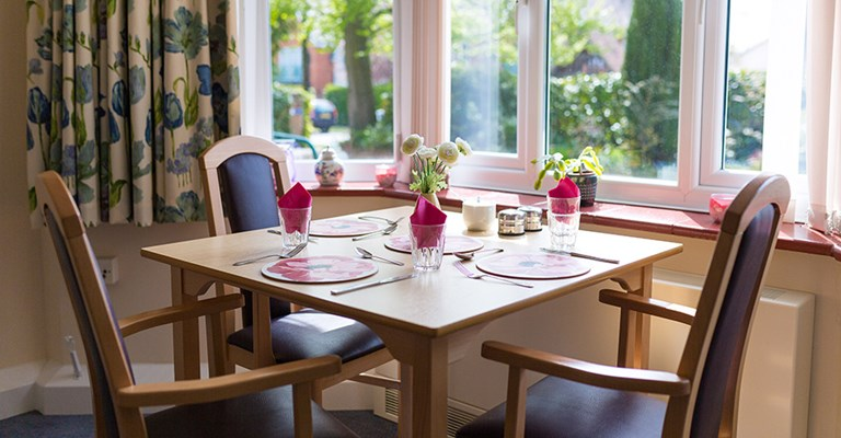 Bright dining room where residents come together to share meal times at Mansil House