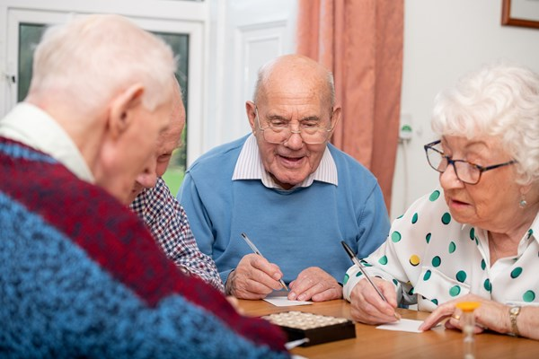 Residents enjoying a word game together