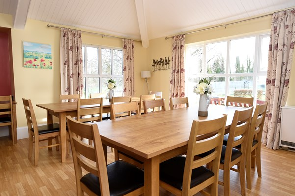 Dining area with large wooden tables