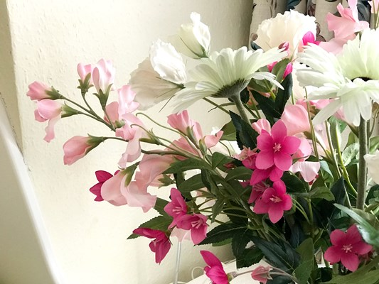 Beautifully arranged white and pink flowers in a vase