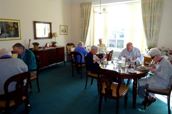 Residents sat in the dining area enjoying lunch