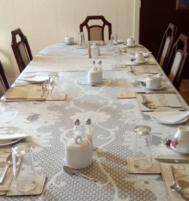 A long dining table set for dinner