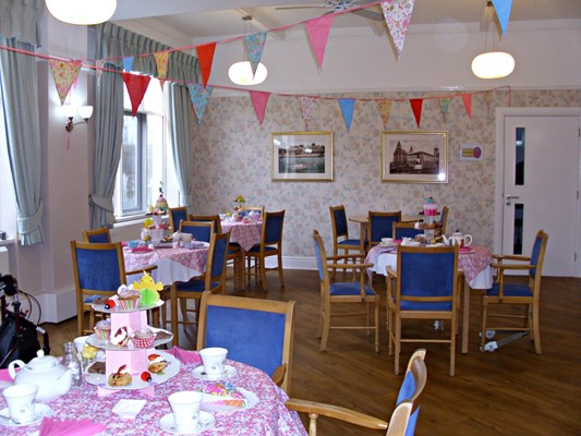 Dining area set for afternoon tea with bunting