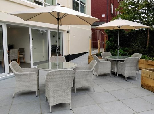 Bright patio area with tables and chairs