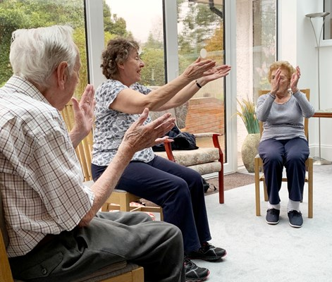 Residents joining in with some armchair exercises at The Wyke