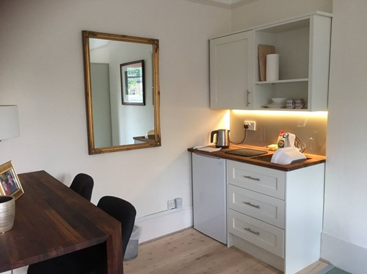 Modern kitchenette area in resident room at Abbeyfield House, Dulwich