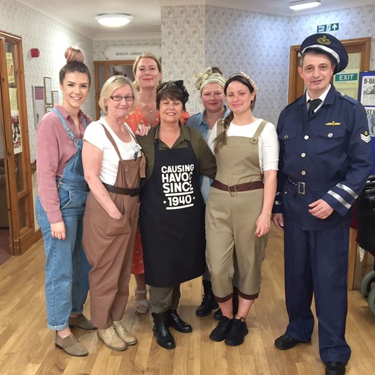 Abbeyfield staff dressed in WWII clothing for D-Day celebrations