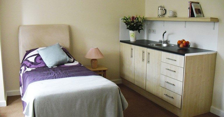 Resident bedroom at Mansil House with kitchenette area