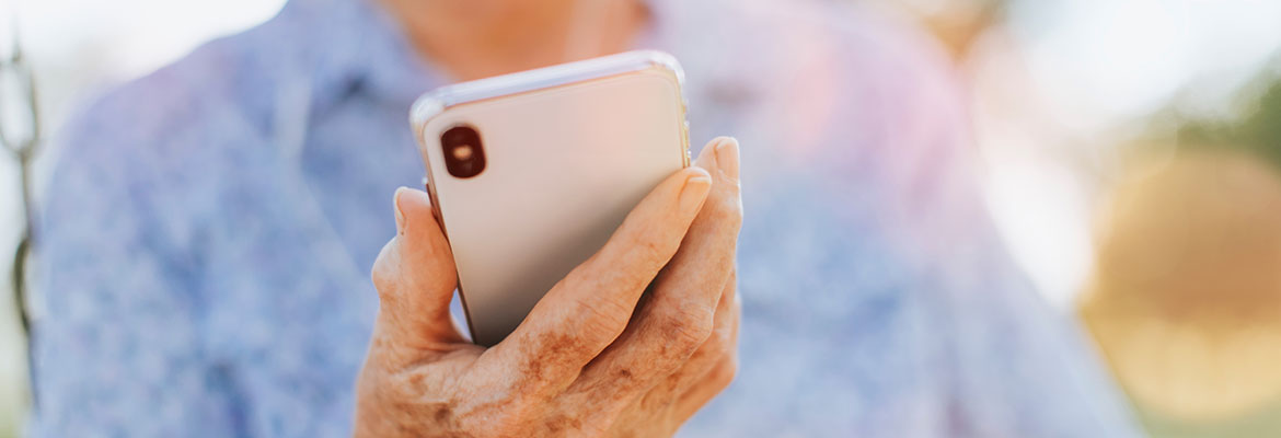 Older woman browsing on a smart phone