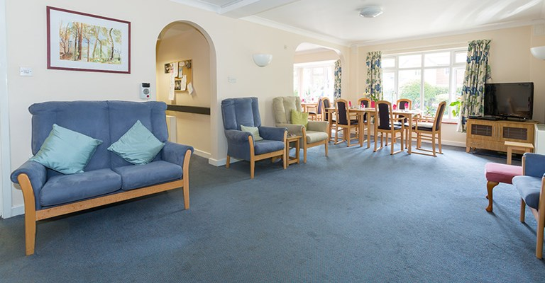 Bright open plan communal lounge and dining room where residents can eat, relax and socialise together