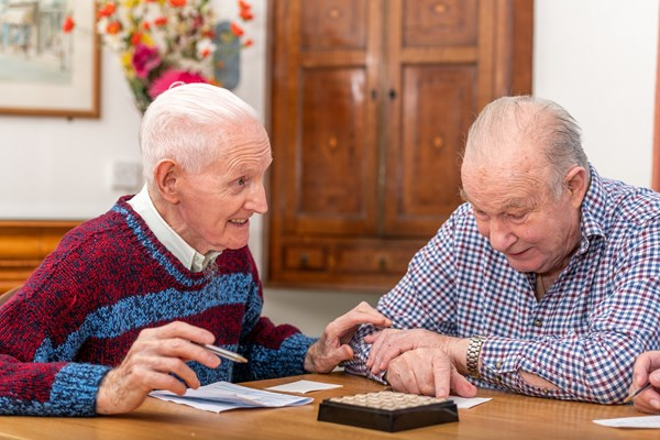 Residents playing boggle together at Cotmaton House
