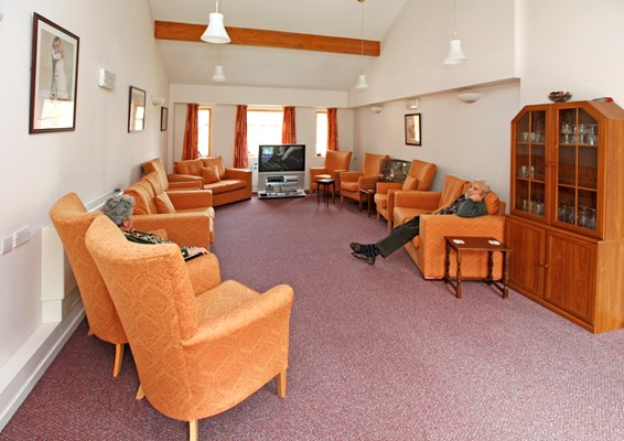 Residents sitting in the spacious communal lounge