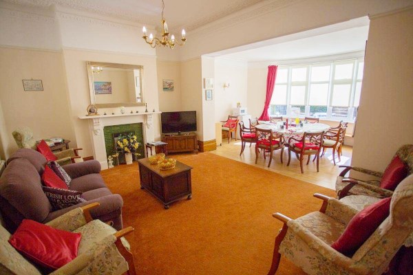 Spacious lounge and dining room for residents at Beamsley House