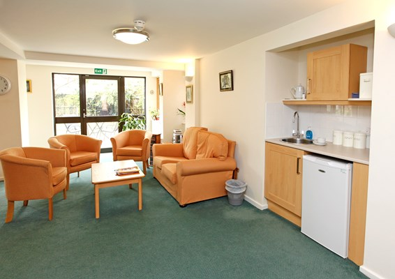 Seating area with kitchenette where residents can socialise and make drinks for themselves