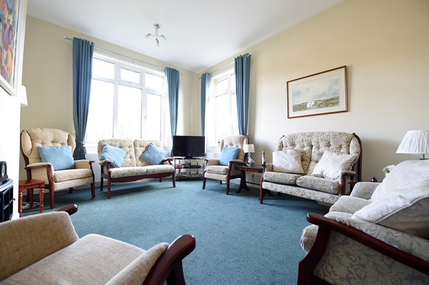 Cosy lounge area with ample seating for the residents