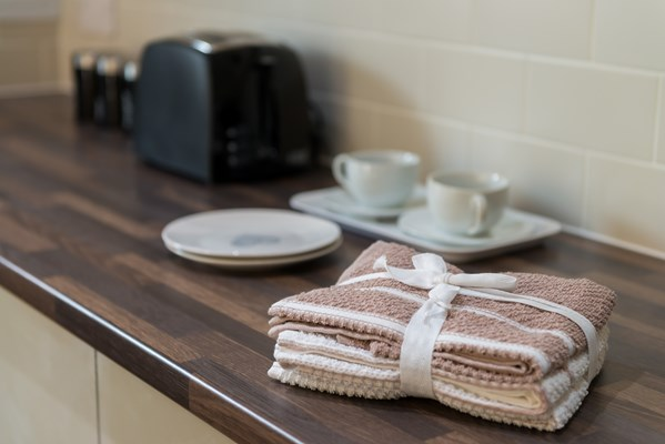 Tea towels and crockery on the kitchen side