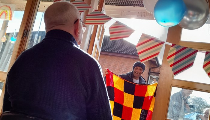 Watford legend surprises care home resident Des on his birthday