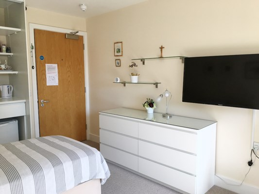 Resident room with kitchenette area at Rider House